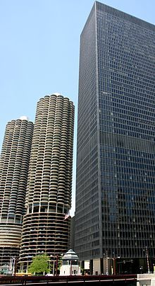 Contrasts in modern architecture, as shown by adjacent high-rises in Chicago, Illinois. IBM Plaza (right), by Ludwig Mies van der Rohe, is a...