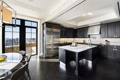Dark cabinet kitchen with calacatta classic marble counters and white subway tile backsplash