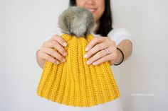 Add a pop of color to your fall and winter wardrobe with this Lolly-Poms Ribbed Crochet Beanie. This beginner-friendly crochet hat pattern is so easy to work up that anyone can do it. Make a matching hat for all your family and friends!