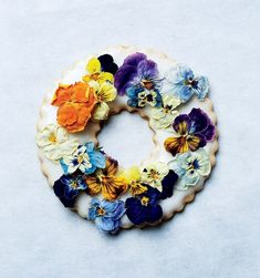 "Candied herbs, edible dried flowers, and freeze-dried berries are beautiful decorations for these iced cookie wreaths. Learn how to make the shortbread <a href=""http://www.bonappetit.com/test-kitchen/how-to/article/lavender-shortbread"">in this video.</a>"