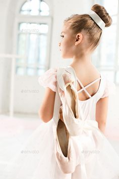 Little ballerina girl in a tutu. Adorable child dancing classical ballet in a white studio. by Little ballerina girl in a tutu. Adorable child dancing classical ballet in a white studio. Photography Kids, Ballerina Photography, Dance Photography Poses, Little Girl Ballerina, Little Girl Dancing, Dance Picture Poses, Dance Poses, Ballet Pictures, Dance Pictures