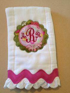 Monogrammed and appliqued burp cloth. $12.00, via Etsy.