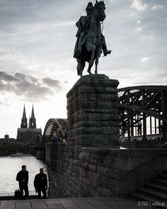 The High Cathedral of Saints Peter and Mary (Kölner Dom), the Hohenzollern Bridge (Hohenzollernbrücke) and the Kaiser Wilhelm II equestrian statue over Rhine (Rhein) riverbanks in Cologne (Köln), Germany