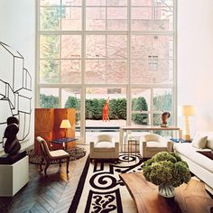big windows. Delphine Krakoff. Could not love this any more! Imagine watching thunder storms, snow fall or even The stars :)