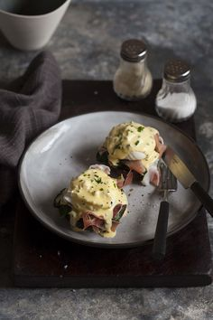 eggs benedict on roasted brown mushrooms wilted spinach prosciutto