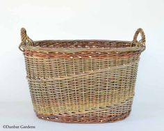 oval willow basket with roped handles and English randing