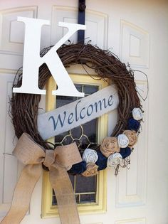 Oversized letter welcome banner grapevine wreath with burlap bow and fabric rosettes