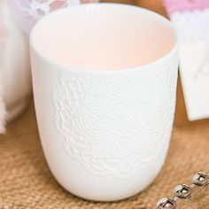 Let+the+twinkling+light+from+a+candle+shone+from+within+these+stunning+white+porcelain+embossed+lace+votive+candle+holders.