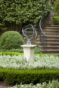 Simple sculpturing. Pruned hedging, mass planting with single plant/color, pedestal with object.