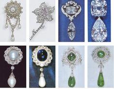 QEII Brooches. L to R top: Duchess of Teck Corsage, Williamson Pink Diamond, Cullinan 6 & 8, Cullinan 3 & 4, Cambridge Pearl Drop, Russian Sapphire Drop, Cambridge Emerald Drop 1, Cambridge Emerald Drop 3