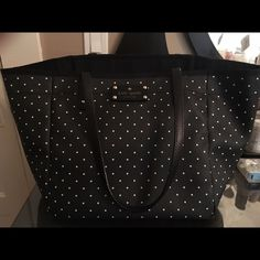 Adorable Kate Spade purse Black with white polka dots, good condition! No outside scratches noted. Has a clasp to partially shut the purse. med in size. Accepting offers! kate spade Other