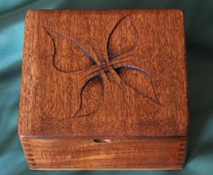 This is a well-constructed wooden box that once held fine cigars in the store. I have transformed it into a wonderful keepsake/storage box by carving a graphic design into the lid of the box. The design is my own and unique. It symbolizes resurrection. It has been subtly toned using pyrography and wood stain. The box wood is Honduran mahogany, or some other tropical hardwood, and has very interesting grain patterns. All the external printed labels have been removed and the box top has be...