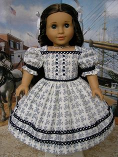 American Girl doll mid-1800s gown made of a premium reproduction cotton that has the year 1855 printed on the selvedge (edge of the fabric), by Tomi Jane, via Flickr