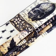 "Dark Gothic Cotton Napkins (Set of 4) ME2Designs Handmade Halloween Table Decor. The handmade beige, tan and black dark Gothic napkins have images of black skulls, bats, crows, bugs, leaves, chandeliers and some squares of text on the fabric. These napkins are a great idea not only for Halloween, but for a unique gift under $50! Each napkin in the set of four is approx. 16.5"" square, and I wash the fabric prior to cutting and after cutting and sewing, so as to reduce fading and shrinkage...."