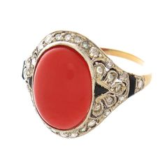 1920s Coral Diamond Platinum Ring. Circa 1920s Platinum Top and 18K yellow Gold shank ring centrally set with a Coral and surrounded by Rose cut Diamonds and further decorated with Faceted Black Onyx. 1920s