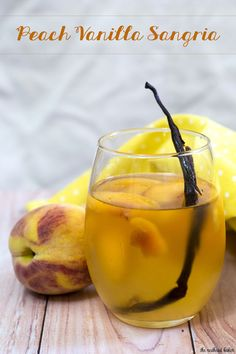 If you try one new cocktail this summer, make it this peach vanilla sangria. Crisp white wine is flavored with peaches, brandy and syrup infused with vanilla bean. TheRedheadBaker.com