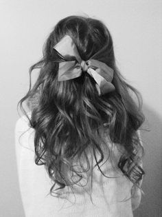 Bows In her hair.