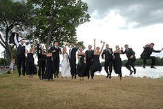 1, 2, 3, jump for the wedding party -  Photo by Bruce Defries Photography located in La Crosse, WI http://www.brucedefriesphotography.com