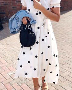 Wherever you're going, the Breanna Polka-Dot Wrap Dress will get you there 📸 @anthro_westport (link in profile to shop)