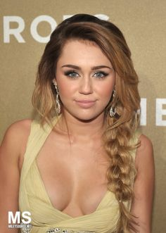 Not a Miley fan, but love the braid.