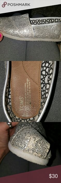 TOMS Beautiful silver sparkly Small for an 8! But in great condition! TOMS Shoes Flats & Loafers