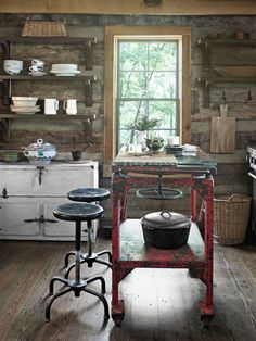An industrial worktable stands in place of an island in this Tennesee kitchen. #decoratingideas