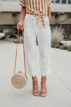 Round bags are so popular for summer. white pants will never be bad. great details - trendy and fashion for 2018