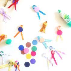 Mini award bows using the Martha Stewart starburst 1-inch punch.  Cute for classroom awards