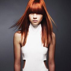 """""""We are #FridayFeeling a little modernist #HairColorMagic with a little gorgeous copper/red mixed with the perfect level of attitude! Hair color by the crazy talented @lupevoss @aveda Cut by > @bastiancasaretto Style by > @genochapman #covetcolor"""""""