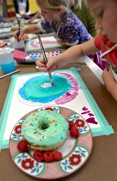 Students at Handmakery art studio in Carbondale, Colorado, paint still life paintings of doughnuts, based on the book Art Workshop for Children by Barbara Rucci.