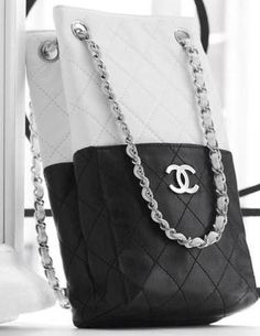 This black and white lambskin Chanel bag with interlaced chain is a reinterpretation of the classic flap bag and is from Chanel's Spring/Summer 2009 collection. I'm not particularity fond of the way the color blocking is done, though at least the colors make it fairly versatile when it comes to matching the bag with …