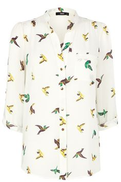 Get tropical this season in our pretty parrot printed shirt. The piece features an open collar and metallic button fastenings on the lapel. The shirt is finished with roll sleeves to give the option of wearing two ways.