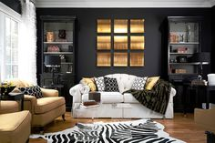 amazing black room. note the use of white & gold in this space.