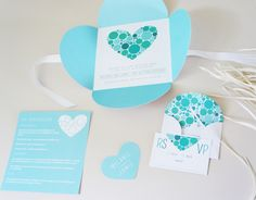 Pompa, Mint & blue wedding stationery with a petal fold style invitation and bespoke hand lined envelopes