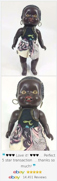 """Wonderful vintage black ethnic celluloid toddler doll, African mold with open mouth and 2 teeth.  12"""", hoop earrings, painted eyes - charming addition to your collection."""