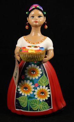 "- Flower Seller (Daisies), ""Lupita"", Mexican Ceramic Figurine with red dress. - The figurine is 11-1/2"" tall and 6 1/4"" wide at the base. - Please note all details. This figurine has the Dress,Apron &"