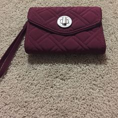 Vera Bradley wristlet in dark burgundy Excellent condition dark red/burgundy turn lock wristlet. Plenty of room for cards, money and a small phone Vera Bradley Bags Clutches & Wristlets