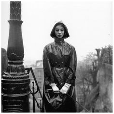 Actress Karen Blanguernon (1935-1996), raincoat with gold buttons and removable cap from CCC, photo by Georges Dambier,February 2, 1959