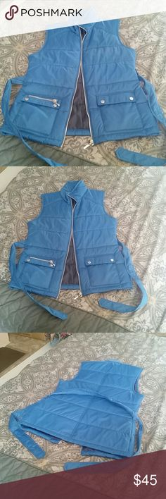 Vest Awesome vest sad to see it go but it does not fit in excellent used condition very comfortable and lightweight looks great with boots sneakers or shoes its a teal and navy blue Merona Jackets & Coats Vests