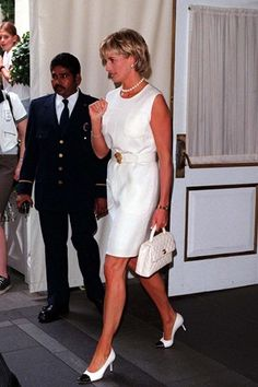 JUNE 1997 – Wearing a white dress and classic white Chanel accessories, Diana attended the auction of her dresses at Christie's in New York