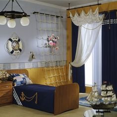 Not usually a fan of the nautical look, but this room is too cute.  Especially the rope net for stuffed animals!