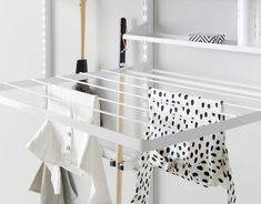 Organize your laundry room and cleaning cabinet with one of our smart storage solutions here. Keep your laundry and cleaning supplies in order with Elfa! Metal Shelves, Wire Shelving, Wall Clips, Pants Rack, Cleaning Cabinets, Shelf Dividers, Garage Storage Solutions, Closet Rod, Hobby House