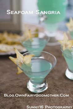 Seafoam Sangria -  3 parts white wine, 2 parts blue Hpnotiq Liquer, 1 part Ginger Ale. Large batches are easy to prepare and can be served over ice or chilled.