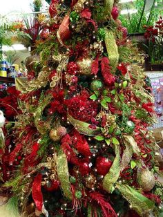 Red and green #Christmas tree. Designed by Arcadia Floral and Home Décor