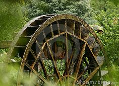 Old water mill wheel by Evron, via Dreamstime