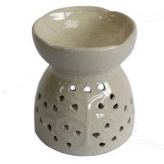 Our range of oil and wax burners covers a huge selection of designs and colours and, whether you are using them as decoration or for infusing your home with fragrance, they are great value for money. As with all our wax and oil burner items, they come with full safety information which we recommend you read before use. This item can be used with oil and water, wax melts or granules. Always use a good quality standard tea light and do not overfill the dish. Material: Ceramic