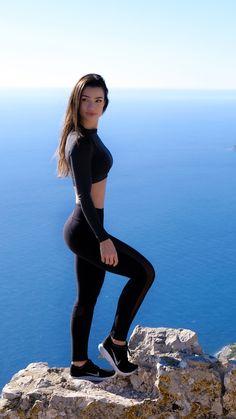 Reach new heights. Gymshark Athlete, Sissy Mua sporting the Sleek Aspire Leggings in Black and Vital Seamless Crop Top in Black Marl.