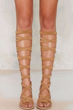 Raise it up in the Jeffrey Campbell Enyo Knee-High Suede Sandal for summer fun!