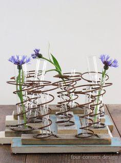 Test tubes vases in bed springs