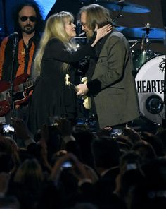 "(Photo by Chris Pizzello/Invision/AP). Stevie Nicks, left, and honoree Tom Petty perform ""Stop Draggin' My Heart Around"" at the MusiCares Person of the Year tribute at the Los Angeles Convention Center on Friday, Feb. 10, 2017."